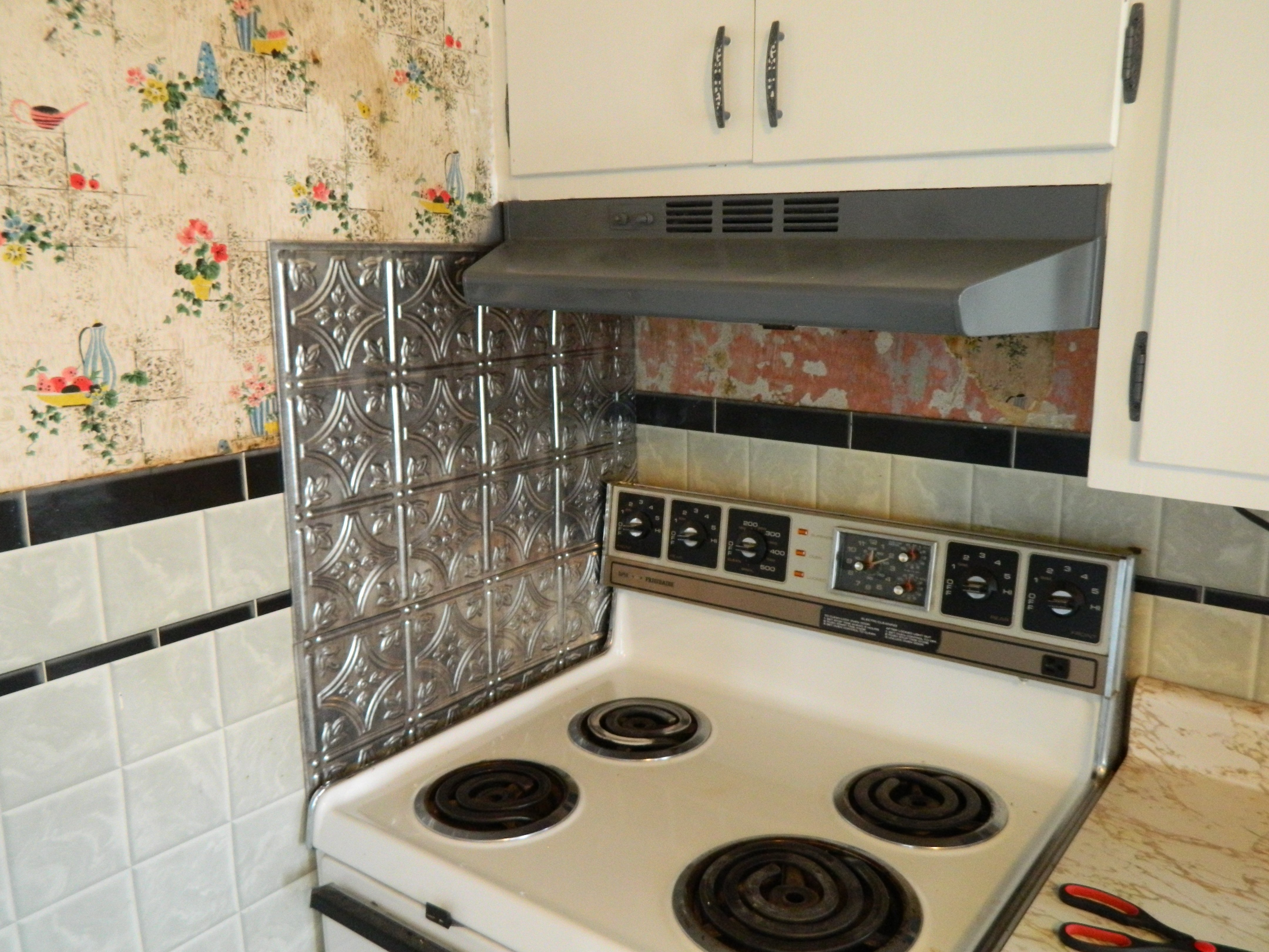 even frozen pizza looks better next to this fancy backsplash we are